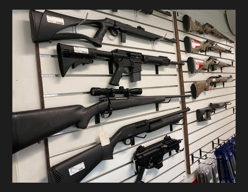 Guns on racks in store